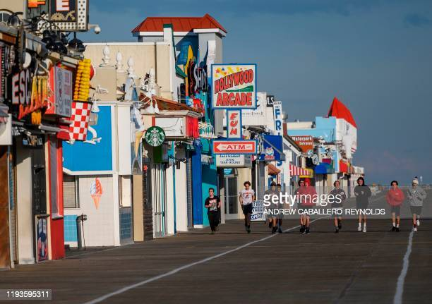 High school team runs down an empty boardwalk in Ocean City, New Jersey on January 8, 2020.