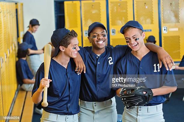 High school teammates in locker room after baseball game