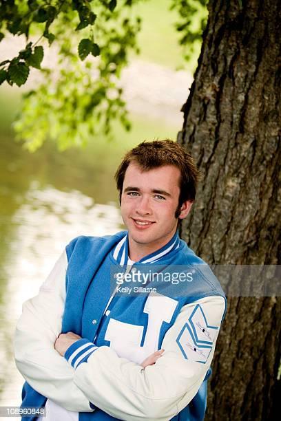 High school varsity athlete in letterman jacket