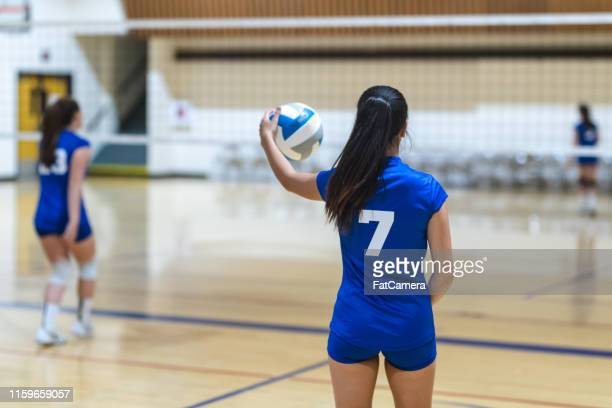 high school volleyball match - volleyball stock pictures, royalty-free photos & images