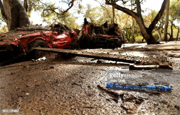 A high school year book sits near mangled cars near Olive Mill Road in Montecito after a major storm hit the burn area Tuesday January 9 2018 in...
