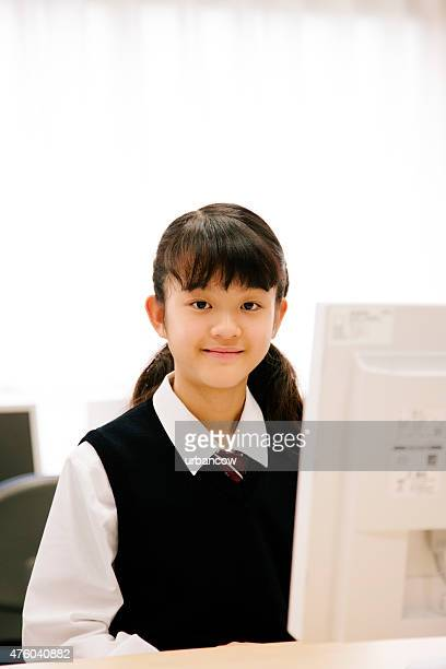 High school. Young, female student uses the computer laboratory, Japan