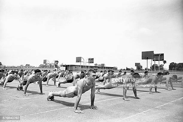 High schools students position themselves for pushups in a particularly rigorous physical education class May 1958 Carmichael California