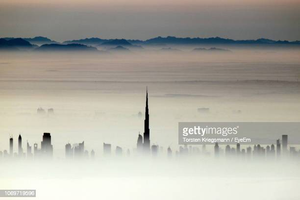 high section burj khalifa and skyscrapers during foggy weather - high section stock pictures, royalty-free photos & images