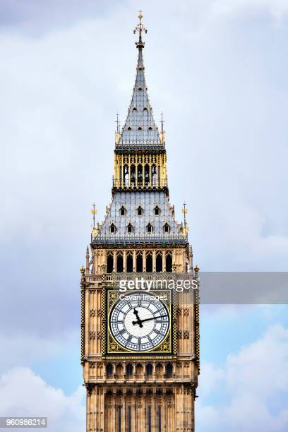 high section of big ben against cloudy sky - big ben stock pictures, royalty-free photos & images