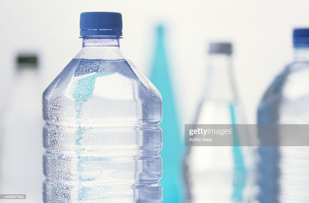 High section of bottled water, close up : Photo