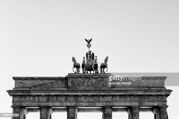 High section of Brandenburg Gate against sky, Berlin, Germany