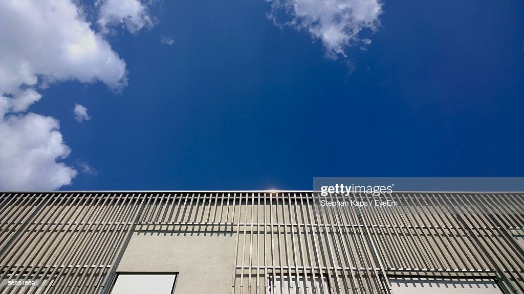 High Section Of Building Against Blue Sky : Stock Photo