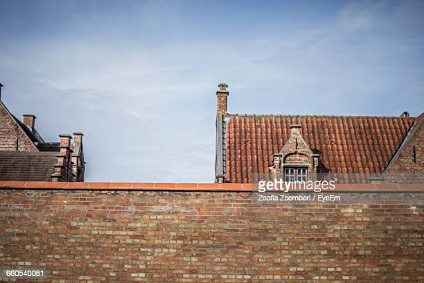 high section of building against cloudy sky - high section stock pictures, royalty-free photos & images