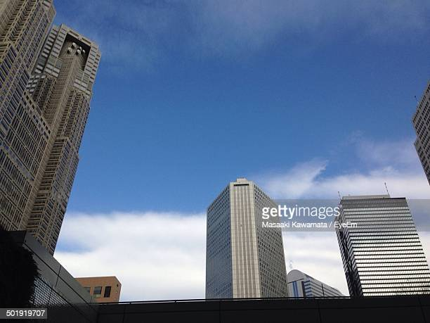 High section of buildings against blue sky