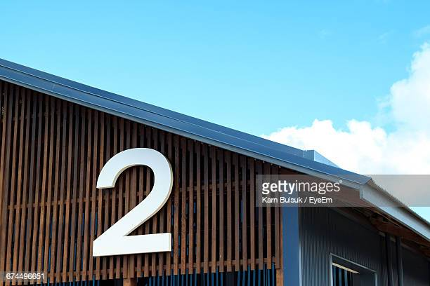 high section of built structure against blue sky - number 2 stock pictures, royalty-free photos & images