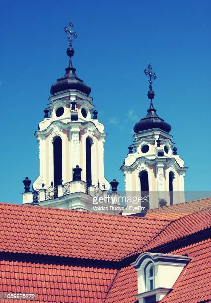 high section of church against clear sky - vilnius stock pictures, royalty-free photos & images