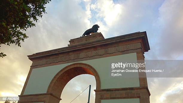 high section of historical building against sky - guanajuato stock pictures, royalty-free photos & images