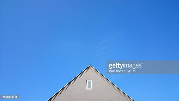 high section of house against clear blue sky - high section stock pictures, royalty-free photos & images