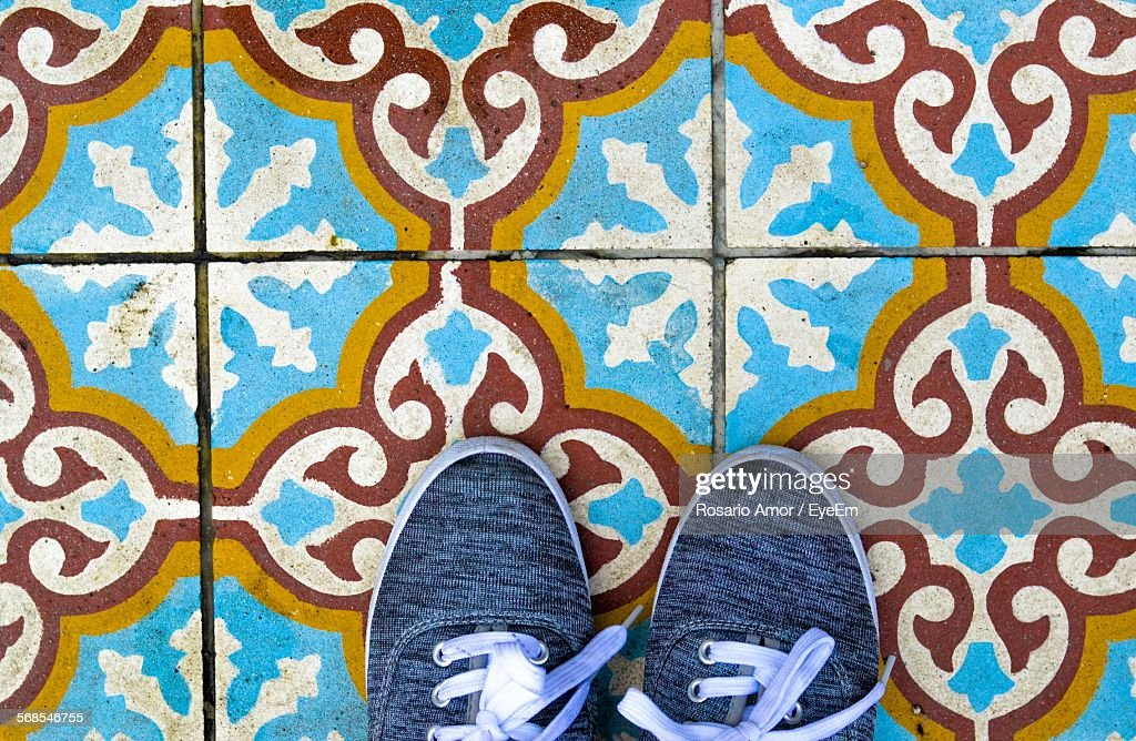 High Section Of Person On Tiled Floor : Stock Photo