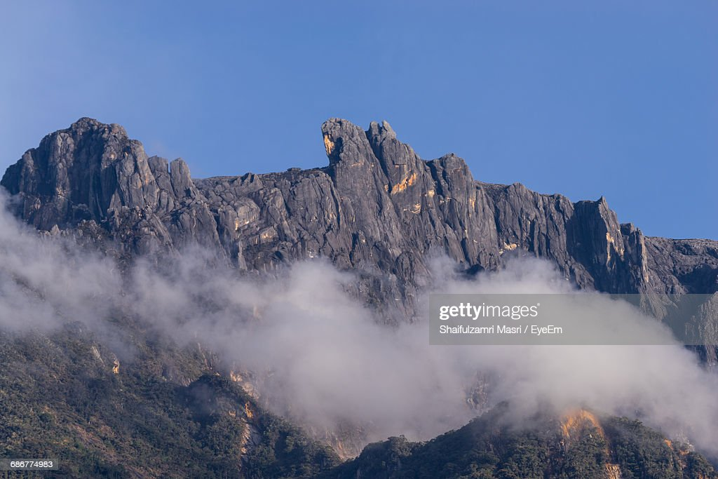 High Section Of Rocky Mountain Against Clear Blue Sky : Stock Photo