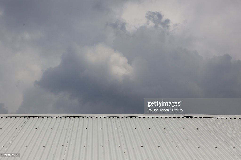 High Section Of Rooftops Against Clouds : Stock Photo