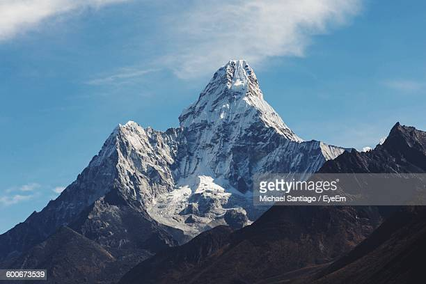high section of snow covered peak against sky - high section stock pictures, royalty-free photos & images