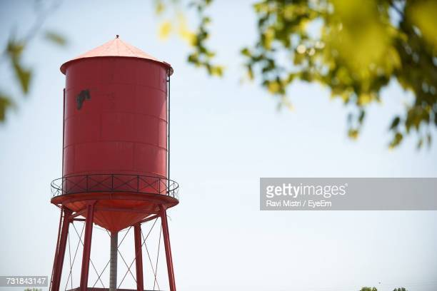 high section of storage tank against sky - water tower storage tank stock pictures, royalty-free photos & images