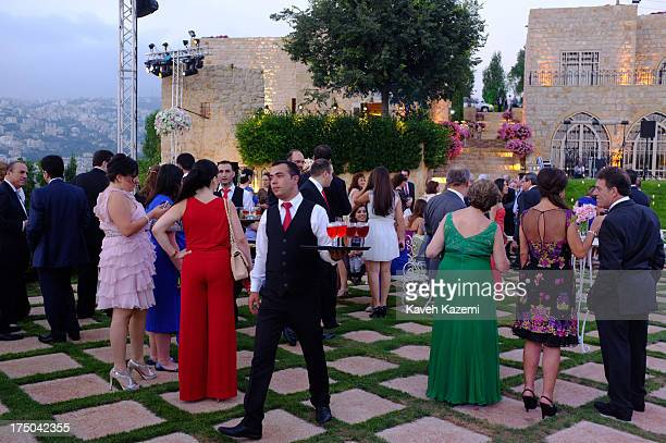 High society Lebanese attend a wedding ceremony on the outskirts of the capital on July 19 2013 in Beirut Lebanon Despite the rising tensions between...