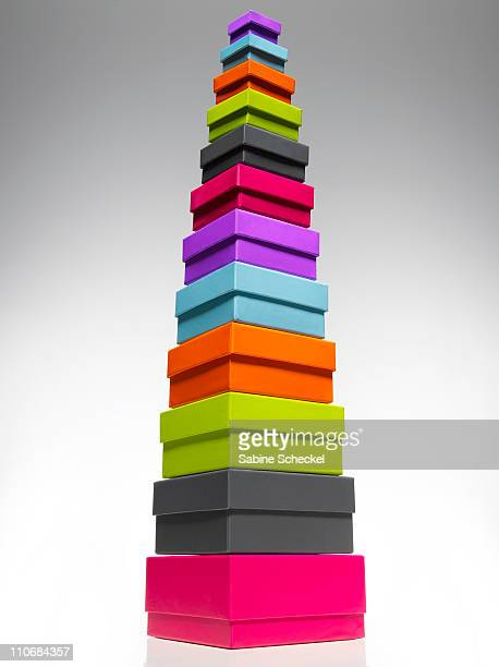 high stack of colored boxes, studio shot