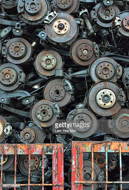 CONTENT] A high stacks of car rotors in this scrap metals yard