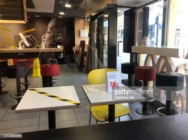 High street branch of McDonald's marks out social distancing tables for delivery drivers as it prepares to open in the coming dayson June 02, 2020 in...