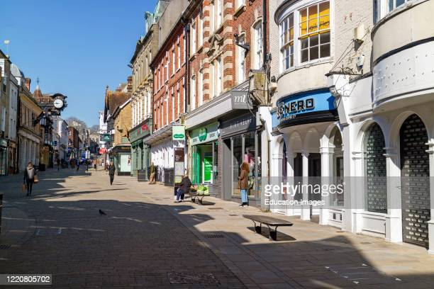 High Street Winchester almost empty with shops cloed due to the Coronavirus pandemic Winchester England UK