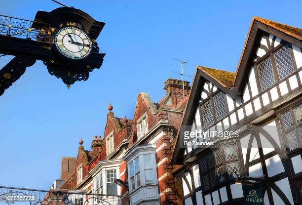 High street with the Town Clock, in Winchester, Hampshire, UK.
