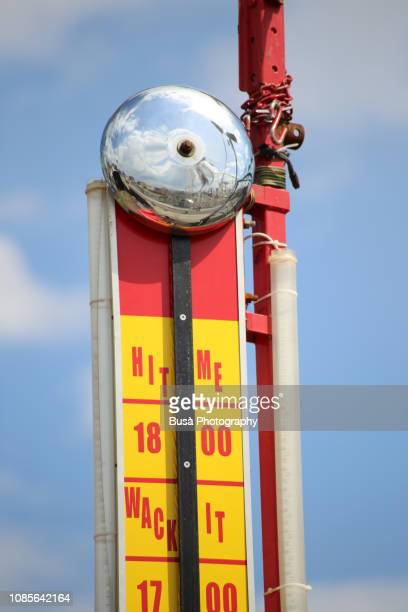 a high striker, also known as a strength tester, or strongman game, photographed at the coney island amusement park, brookyn, new york city, usa - mallet hand tool stock pictures, royalty-free photos & images