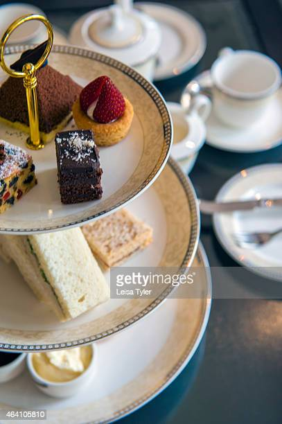 High tea with scones assorted sandwiches and local tea at the Cameron Highlands Resort in Tanah Rata Situated above 1000 meters and blessed with a...