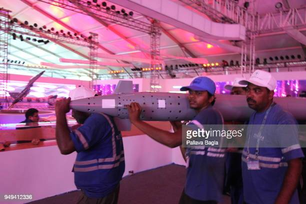 NADU INDIA APRIL 12 A high tech missile being carried on shoulders of workers Indian armed forces air force army and navy gave a joint live...