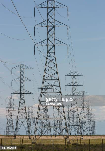 High tension electrical power lines move north and south along Highway 58 as viewed on March 28 near Buttonwillow California Oil and natural gas...
