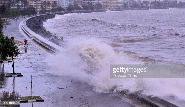 People watch to high tide at Badhwar Park on July 15 2018 in Mumbai India On Sunday Mumbai experienced the highest tide of the season of 497 metres