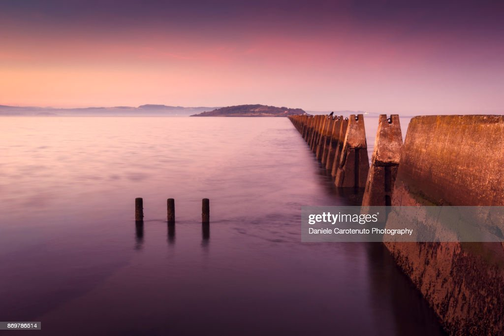 High tide at sunset : Stock Photo