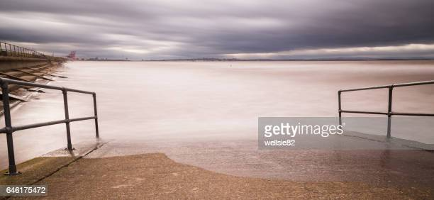 high tide at the slipway - antony gormley stock pictures, royalty-free photos & images