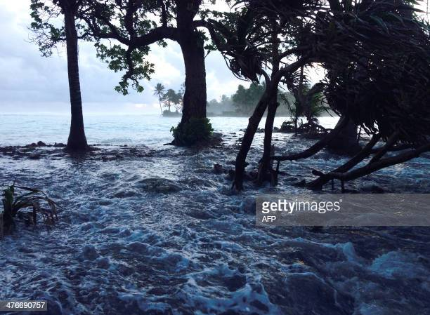 A high tide energized by storm surges washes across Ejit Island in Majuro Atoll Marshall Islands on March 3 causing widespread flooding and damaging...