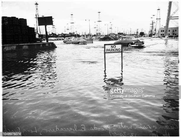 High tide flood 30 December 1951 Howard Campbell 9 years Flooded Pico Street and EmbarcaderoFreighter 'Steel Apprentice' loading at Berth 1A with...