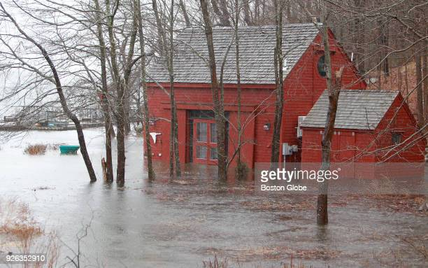 High tide flood water surrounds a building during a nor'easter storm at Lobster Cove in Gloucester MA on March 2 2018