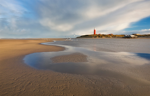high tide on North sea coast with lighthouse, Netherlands 1068373186