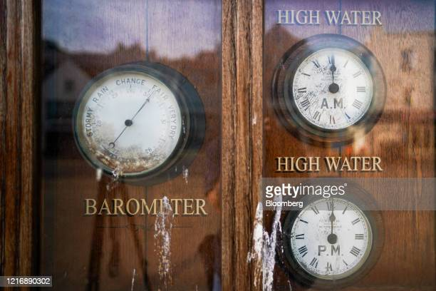 High tide times and a barometer sit on display at the harbour in Scarborough UK on Tuesday June 2 2020 The threat of a nodeal Brexit is back and with...