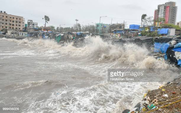 High tide waves at Versova beach on July 14 2018 in Mumbai India Mumbaikars had to face another tough battle as the high tide hit the city at 149pm...