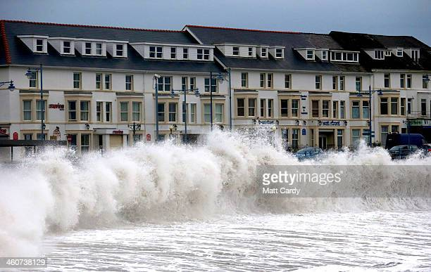 High tide waves break along the seafront at Porthcawl on January 5, 2014 in Mid Glamorgon, Wales. After a period of recent storms and heavy rain,...