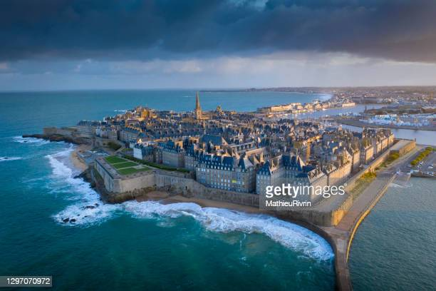 high tides and aerial view at sunrise of saint-malo - local landmark stock pictures, royalty-free photos & images
