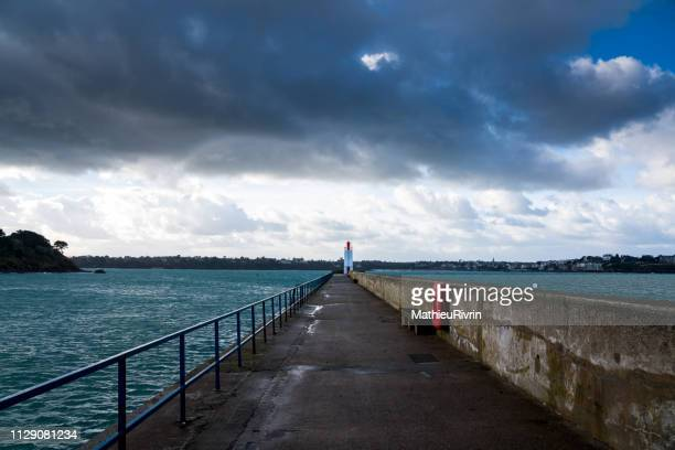 high tides in saint-malo : digue - marée stock pictures, royalty-free photos & images
