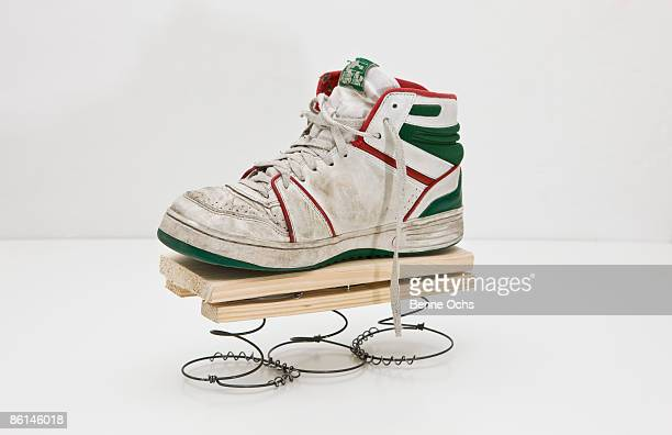 a high top sneaker on a homemade spring - three quarter front view stock pictures, royalty-free photos & images