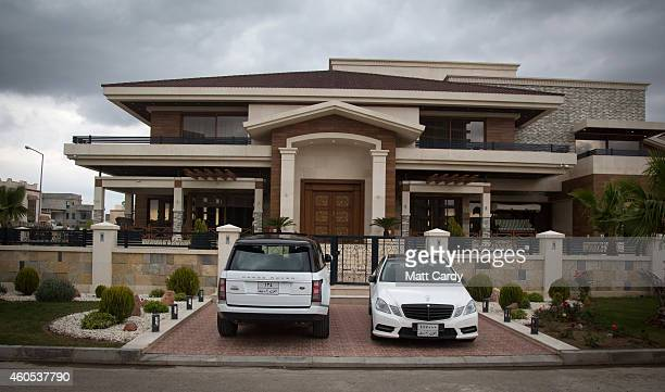 High value cars are parked outside luxury properties inside Dream City a new exclusive residential suburb that is being developed in Erbil on...