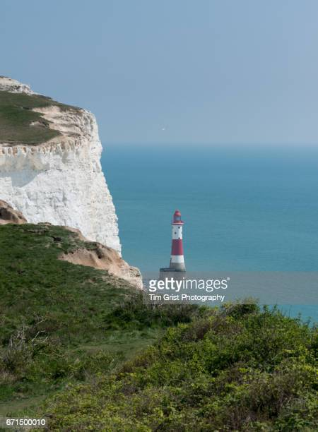 high view of beachy head light house - beachy head stock photos and pictures