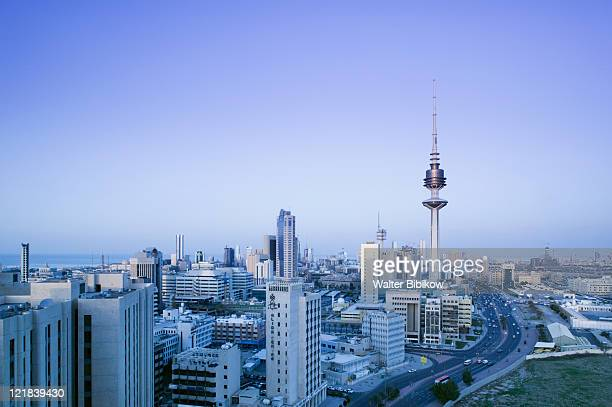 high view of liberation tower and city at sunset, kuwait - kuwait stock pictures, royalty-free photos & images
