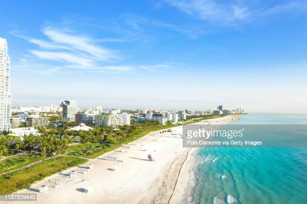 high view of south beach in miami from south pointe park, florida, usa - miami beach south pointe park stock pictures, royalty-free photos & images